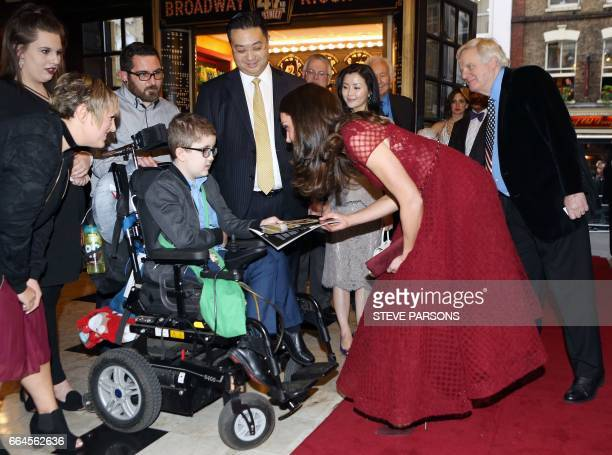 Britain's Catherine Duchess of Cambridge in her role as Patron of East Anglia's Children's Hospice recieves a programme after arriving to attends the...