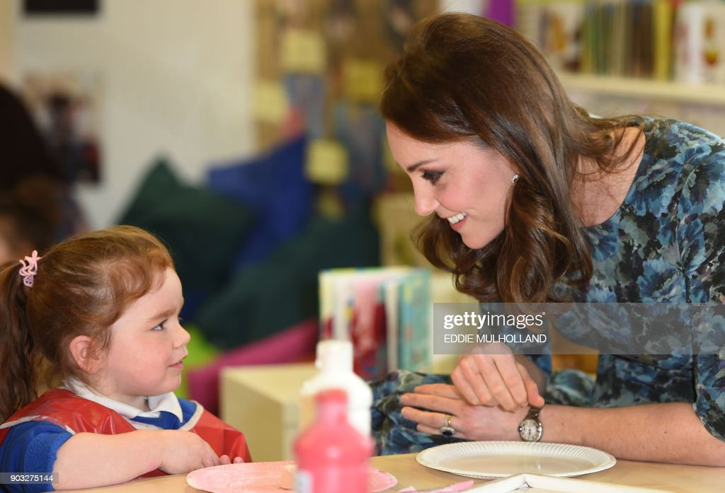 Britain's Catherine, Duchess of Cambridge interacts with children during her visit to the Reach Academy Feltham, a school which supports children, their families and the school community throughout their school career, in Feltham, west London on January 10, 2018. PHOTO / POOL / Eddie MULHOLLAND