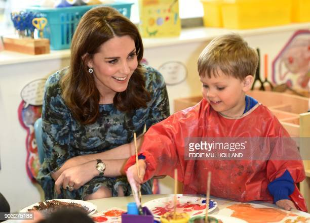 Britain's Catherine Duchess of Cambridge interacts with children during her visit to the Reach Academy Feltham a school which supports children their...