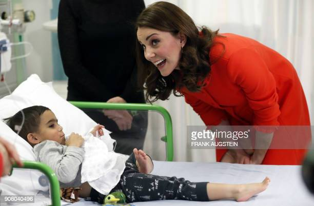 Britain's Catherine Duchess of Cambridge interacts with patient Rafael Chana during her visit to officially open the Mittal Children's Medical Centre...