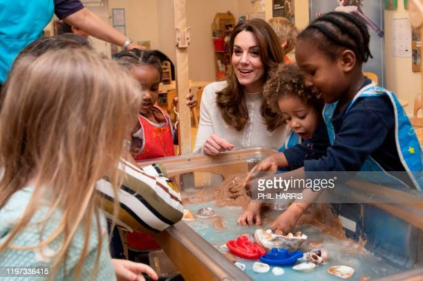 Britain's Catherine, Duchess of Cambridge interacts with young children during a breakfast visit to London Early Years Foundation at Stockwell...