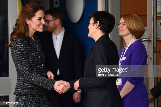 Britain's Catherine Duchess of Cambridge is accompanied by National Portrait Gallery Director Nicholas Cullinan as she leaves after a visit to the...