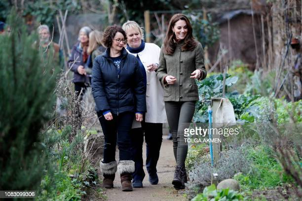 Britain's Catherine Duchess of Cambridge is given a tour of allotments as she visits the Islington community garden in north London on January 15 2019