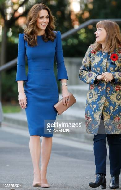 Britain's Catherine Duchess of Cambridge is greeted by Director general of the Imperial War Museum Diane Lees during a visit to the Imperial War...