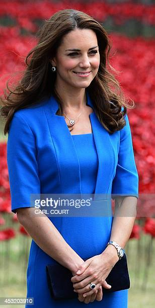 Britain's Catherine, Duchess of Cambridge, is pictured during a visit to the Tower of London's 'Blood Swept Lands and Seas of Red' poppy...