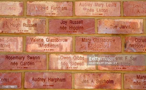 Britain's Catherine Duchess of Cambridge is shown bricks dedicated to her grandmother Valerie Glassborow and aunt Mary Glassborow who both worked at...