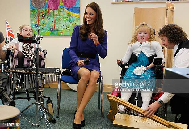 Britain's Catherine Duchess of Cambridge joins in a music class during a visit to The Treehouse in Ipswich eastern England on March 19 2012 The...