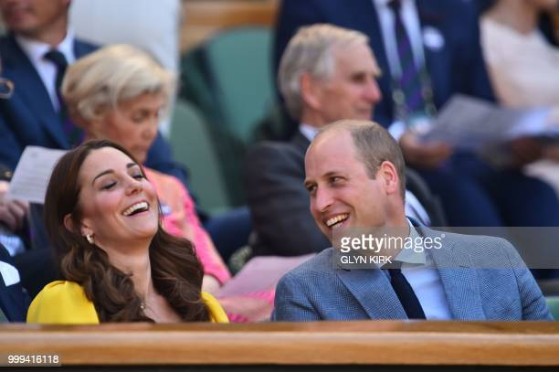 TOPSHOT Britain's Catherine Duchess of Cambridge jokes with her husband Britain's Prince William Duke of Cambridge in the Royal Box before South...