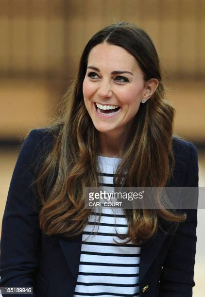 Britain's Catherine Duchess of Cambridge laughs after participating in a volleyball game during a trip to the SportsAid Athlete Workshop in the...
