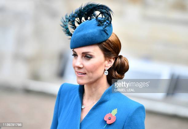 Britain's Catherine Duchess of Cambridge leaves after attending a service of commemoration and thanksgiving to mark Anzac Day in Westminster Abbey in...