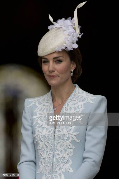 Britain's Catherine, Duchess of Cambridge leaves after attending a national service of thanksgiving for the 90th birthday of Britain's Queen...