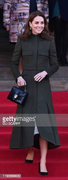 Britain's Catherine Duchess of Cambridge leaves after visiting City Hall in Centenary Square Bradford on January 15 to meet young people and hear...