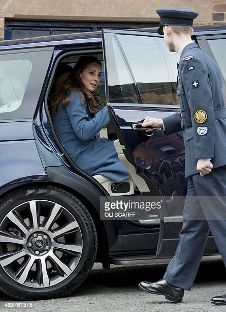 Britain's Catherine Duchess of Cambridge leaves after visiting the 'Emma Bridgewater' pottery factory to view the production of a mug that the...