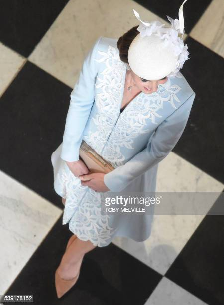 Britain's Catherine, Duchess of Cambridge, leaves at the end of a national service of thanksgiving for the 90th birthday of Britain's Queen Elizabeth...
