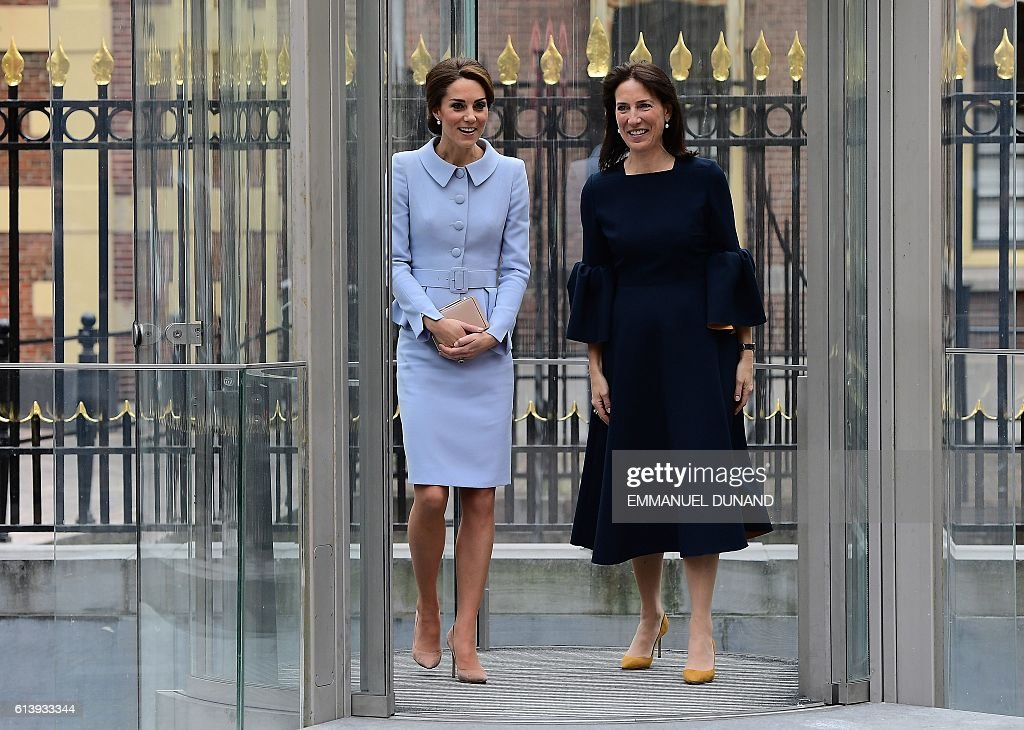 Britain's Catherine, Duchess of Cambridge (L) leaves with Mauritshuis' museum director Emilie Gordenker after visiting the exhibition 'Vermeer and Contemporaries from the British Royal Collection' at The Mauritshuis art museum - home to the best of Dutch Golden Age painting, in The Hague, the Netherlands, on October 11, 2016. Britain's Catherine, Duchess of Cambridge is on her first official foreign solo visit. / AFP / EMMANUEL