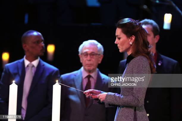 Britain's Catherine, Duchess of Cambridge lights a candle during the UK Holocaust Memorial Day Commemorative Ceremony at Methodist Central Hall in...