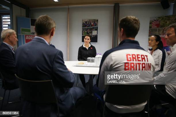 Britain's Catherine Duchess of Cambridge listens during a briefing from representatives of the LTA during a visit at the Lawn Tennis Association at...
