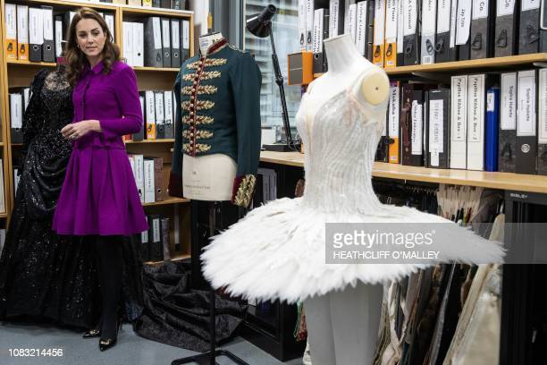 Britain's Catherine Duchess of Cambridge looks at a costume in the pattern room during a visit to the costume department at the Royal Opera House in...