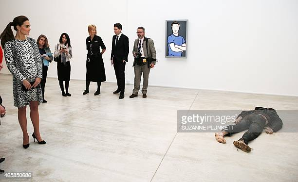 Britain's Catherine Duchess of Cambridge looks at the art work Self Portrait as a Drowned Man by British artist Jeremy Millar during a visit to...