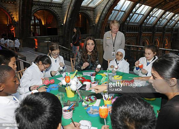 Britain's Catherine Duchess of Cambridge makes a dinosaur egg with pupils from Oakington Manor Primary School at the Natural History Museum in London...