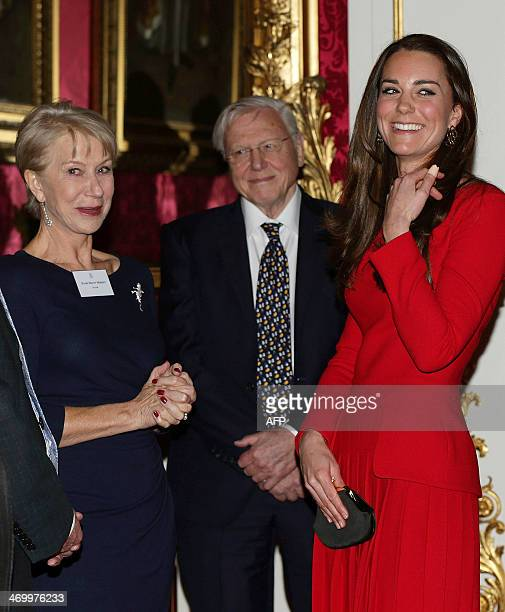 Britain's Catherine Duchess of Cambridge meets British actress Helen Mirren as television personality Sir David Attenborough looks on during a...