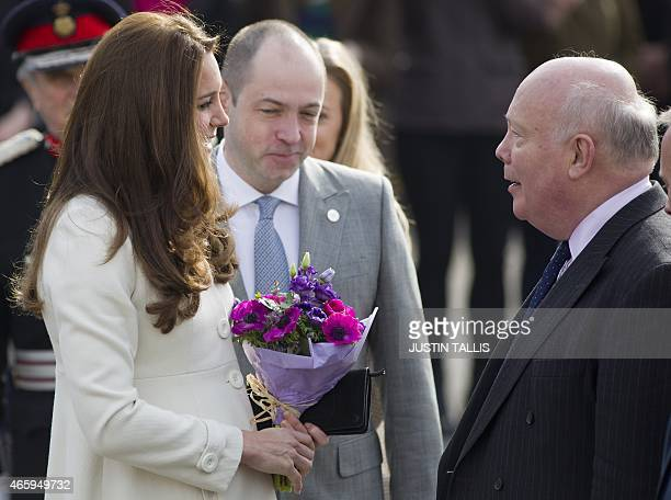 Britain's Catherine Duchess of Cambridge meets British screenwriter Julian Fellowes on the set of British television series Downton Abbey at Ealing...