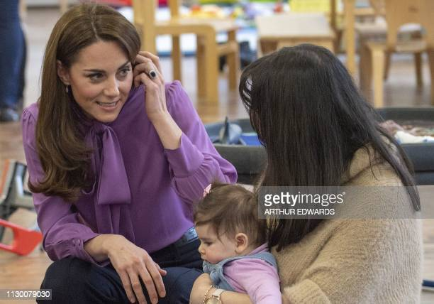 Britain's Catherine Duchess of Cambridge meets children and parents as she visits the Henry Fawcett Children's Centre in London on March 12 2019 The...