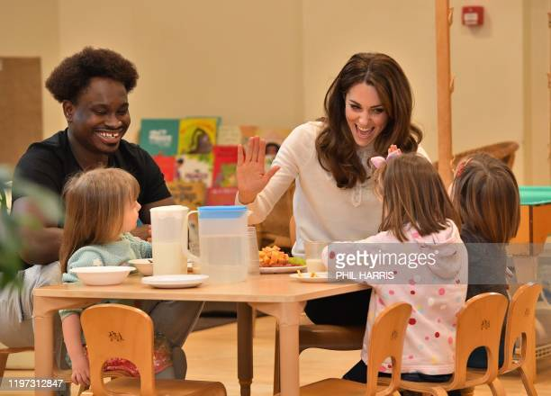 Britain's Catherine Duchess of Cambridge meets children during a breakfast visit to London Early Years Foundation at Stockwell Gardens Nursery and...