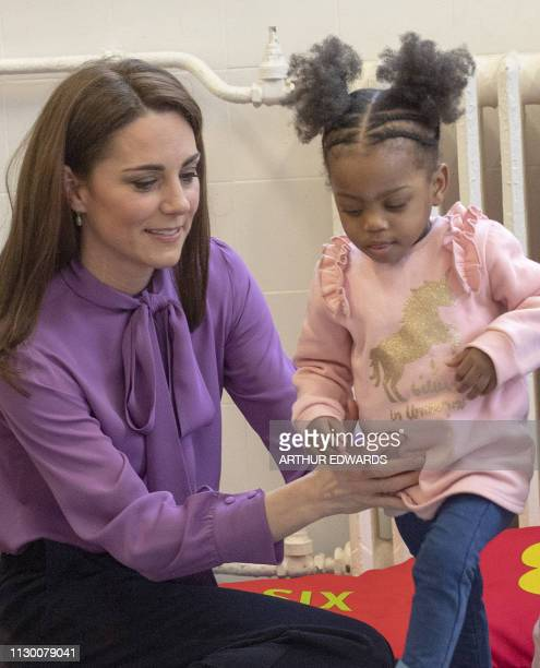 Britain's Catherine Duchess of Cambridge meets children while she visits the Henry Fawcett Children's Centre in London on March 12 2019 The Duchess...