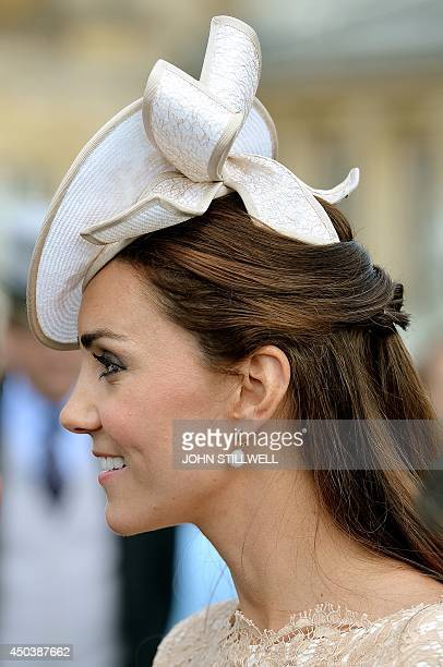 Britain's Catherine Duchess of Cambridge meets guests at a garden party at Buckingham Palace in London on June 10 2014 AFP PHOTO / POOL / JOHN...