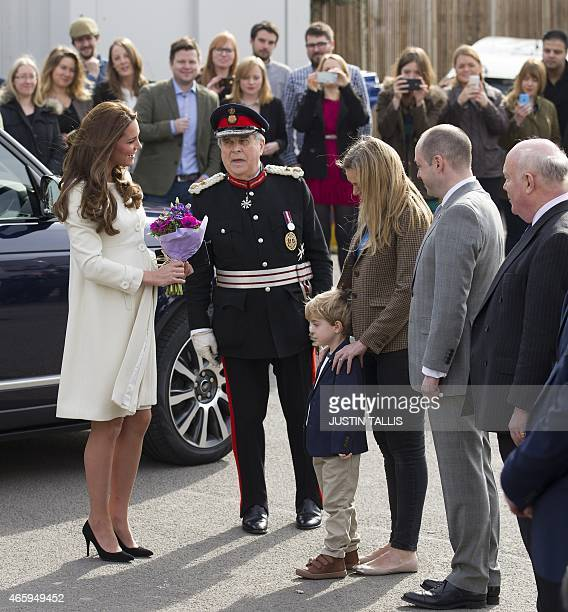 Britain's Catherine Duchess of Cambridge meets members of the cast on the set of British television series Downton Abbey at Ealing Studios in west...