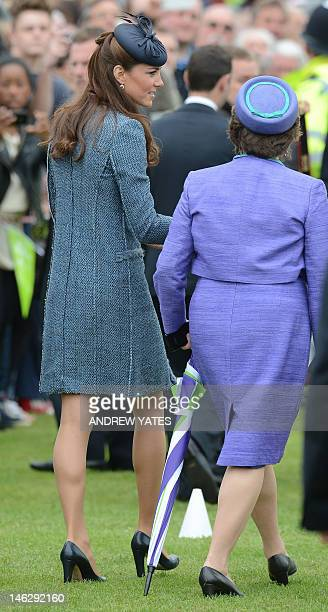Britain's Catherine Duchess of Cambridge meets members of the public during a visit to Vernon Park in Nottingham central England on June 13 2012 with...