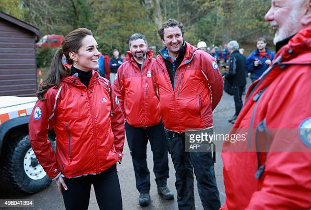 Britain's Catherine Duchess of Cambridge meets mountain rescue personnel as she visits the Towers Residential Outdoor Education Centre in Capel Curig...
