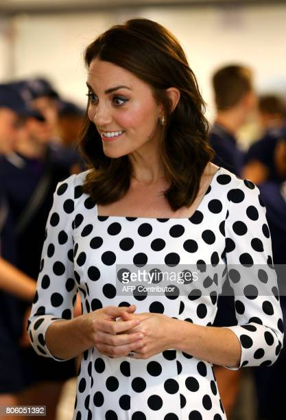 Britain's Catherine Duchess of Cambridge meets with ball boys and girls as she visits The All England Lawn Tennis Club in Wimbledon southwest London...