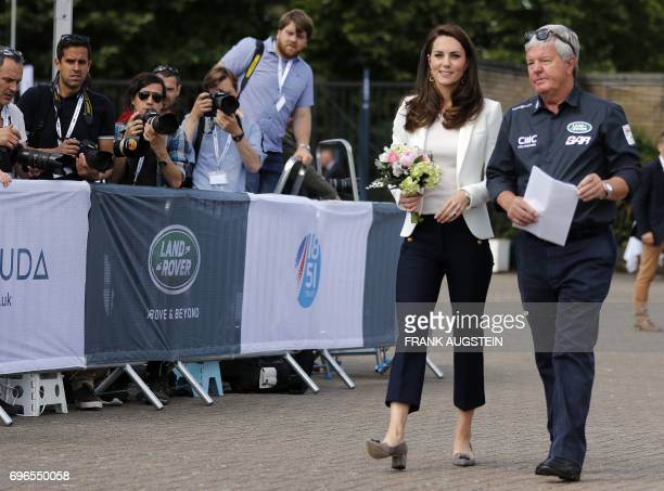 Britain's Catherine, Duchess of Cambridge , Patron of the 1851 Trust, is welcomed by Keith Mills as she attends the charity's final Land Rover BAR...