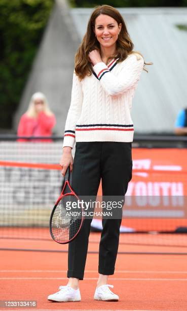 Britain's Catherine, Duchess of Cambridge, plays tennis with local school children as part of the the Lawn Tennis Association's Youth programme, at...