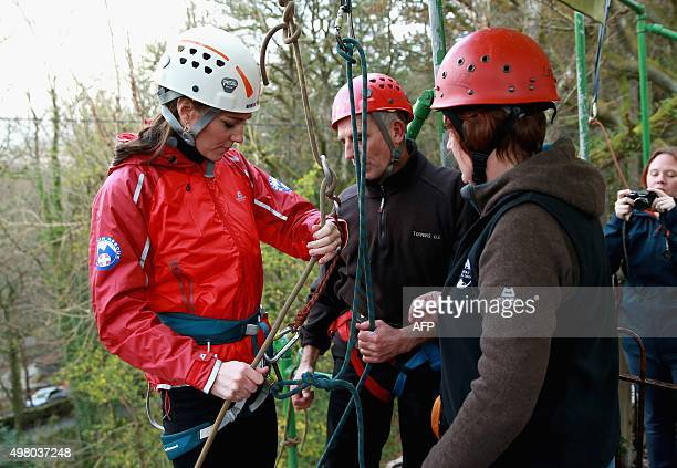 Britain's Catherine Duchess of Cambridge prepares to abseil down a wall during a visit to the Towers Residential Outdoor Education Centre in Capel...