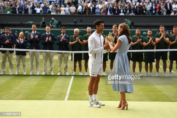 Britain's Catherine Duchess of Cambridge presents Serbia's Novak Djokovic with the winner's trophy during the presetation after he beat beat...