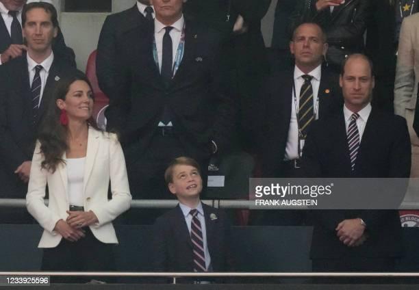 Britain's Catherine , Duchess of Cambridge, Prince George of Cambridge , and Britain's Prince William , Duke of Cambridge, are seen during the UEFA...