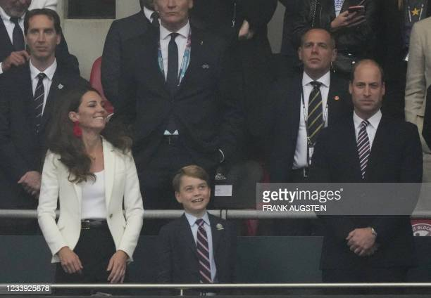Britain's Catherine , Duchess of Cambridge, Prince George of Cambridge and Britain's Prince William , Duke of Cambridge, are seen during the UEFA...
