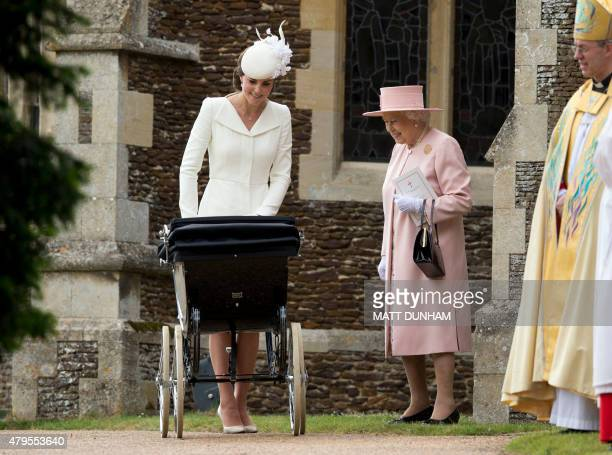 Britain's Catherine, Duchess of Cambridge, pushes her daughter, Princess Charlotte of Cambridge in a pram as Britain's Queen Elizabeth II and...