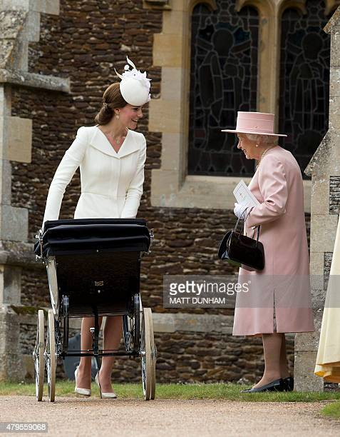 Britain's Catherine, Duchess of Cambridge, pushes her daughter, Princess Charlotte of Cambridge in a pram as she talks to Britain's Queen Elizabeth...