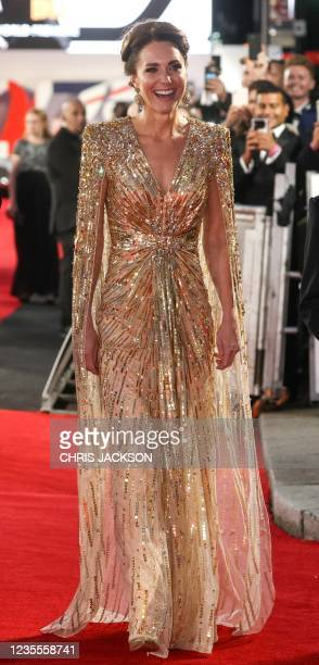 """Britain's Catherine, Duchess of Cambridge reacts as she arrives ahead of the World Premiere of the James Bond 007 film """"No Time to Die"""" at the Royal..."""