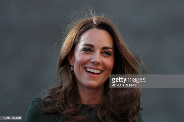 TOPSHOT Britain's Catherine Duchess of Cambridge reacts as she arrives to visit Family Action in Lewisham south London on January 22 where she helped...