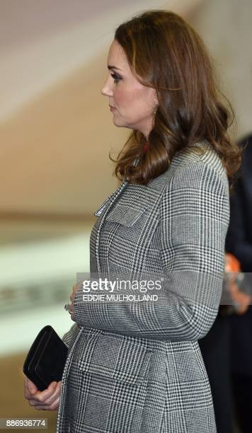 Britain's Catherine Duchess of Cambridge reacts as she arrives to attend the Children's Global Media Summit at the Manchester Central Convention...