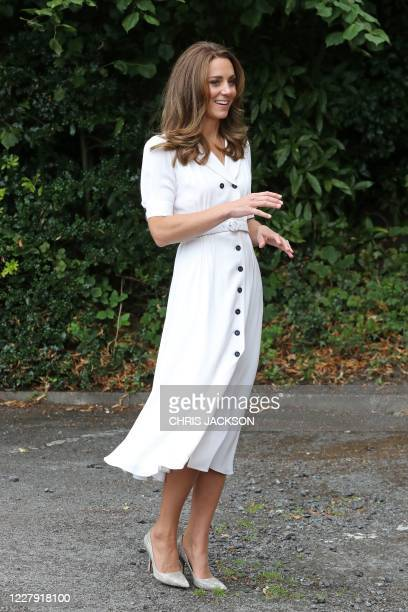 Britain's Catherine, Duchess of Cambridge reacts as she arrives to visit to Baby Basics baby bank in Sheffield, northern England on August 4, 2020. -...