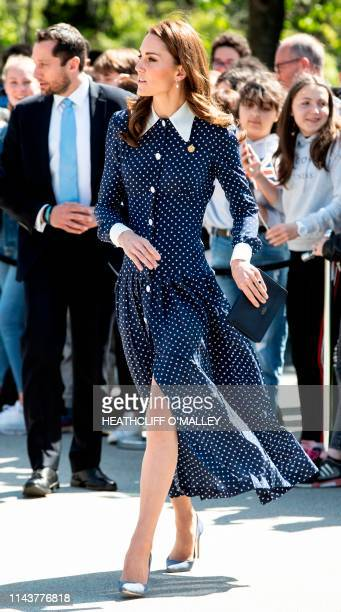 Britain's Catherine Duchess of Cambridge reacts as she is greeted by wellwishers as she arrives to visit Bletchley Park in Bletchley north west of...