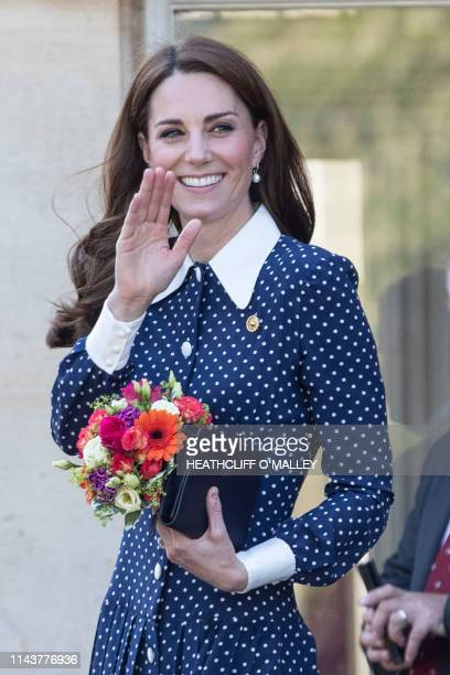 Britain's Catherine Duchess of Cambridge reacts as she is greeted by wellwisher during her visit to Bletchley Park in Bletchley north west of London...
