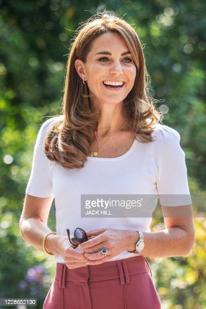 Britain's Catherine, Duchess of Cambridge, reacts as she meets with parents and children, and peer supporters, in Battersea Park, London on September...