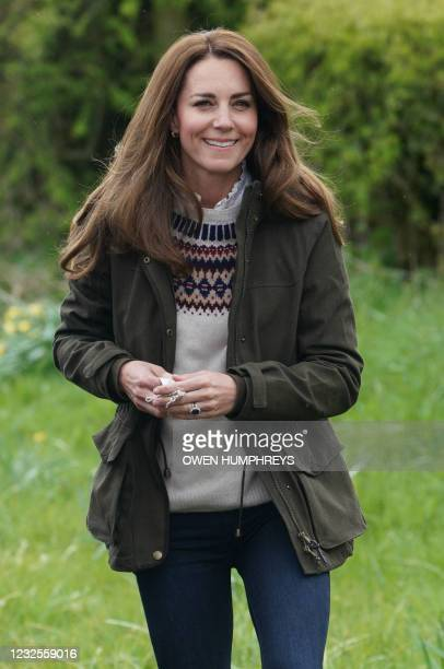 Britain's Catherine, Duchess of Cambridge, reacts during a visit to Manor Farm in Little Stainton, near Durham, north east England on April 27, 2021.